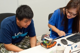 Students work in pairs to build an autonomous robot.